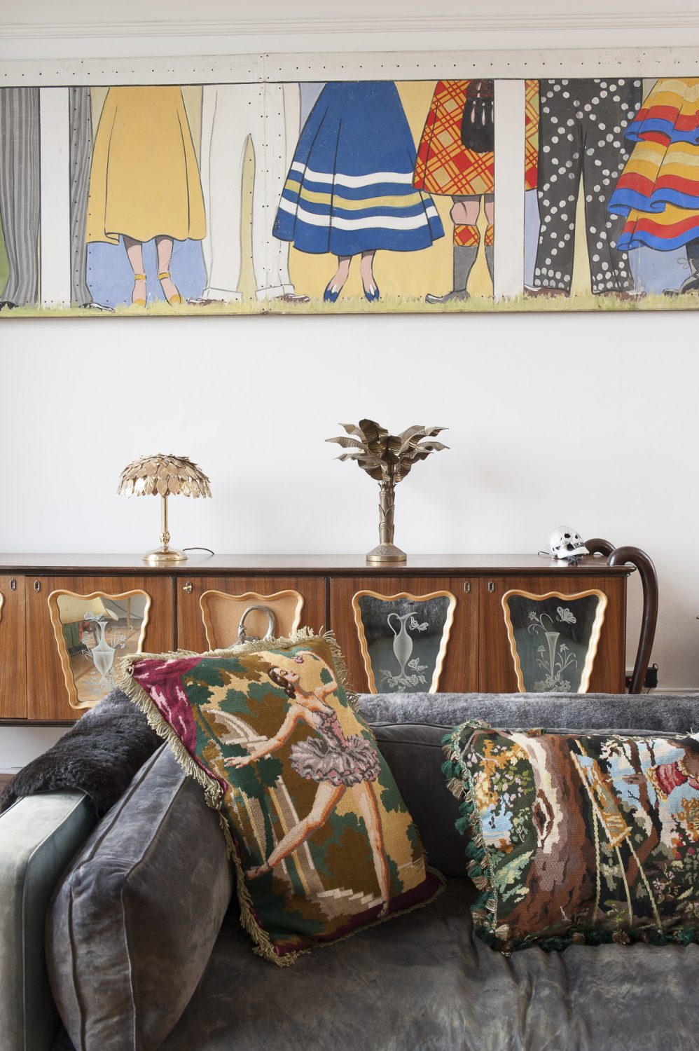 Tapestry cushions adorn a sofa that once belonged to Engelbert Humpadinck, behind which stand two brass palm lamps, one French the other from HarrodsTapestry cushions adorn a sofa that once belonged to Engelbert Humpadinck, behind which stand two brass palm lamps, one French the other from Harrods