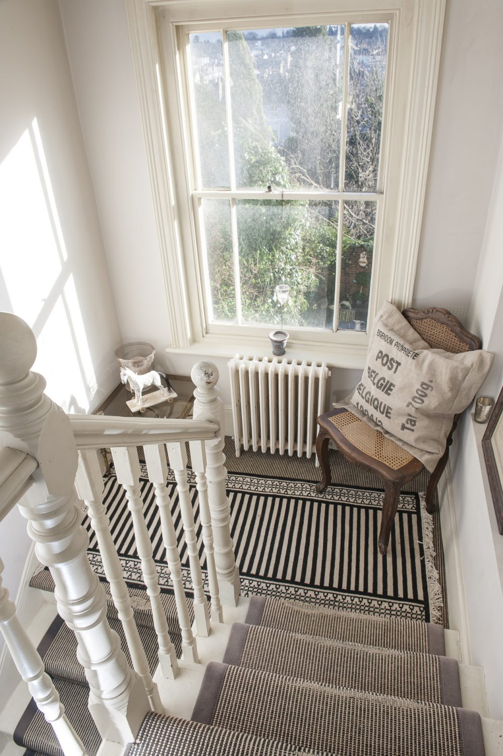 Every corner of Minnie's light and bright home is filled with fascinating finds, including these old Belgian post mail bags re-purposed as cushions