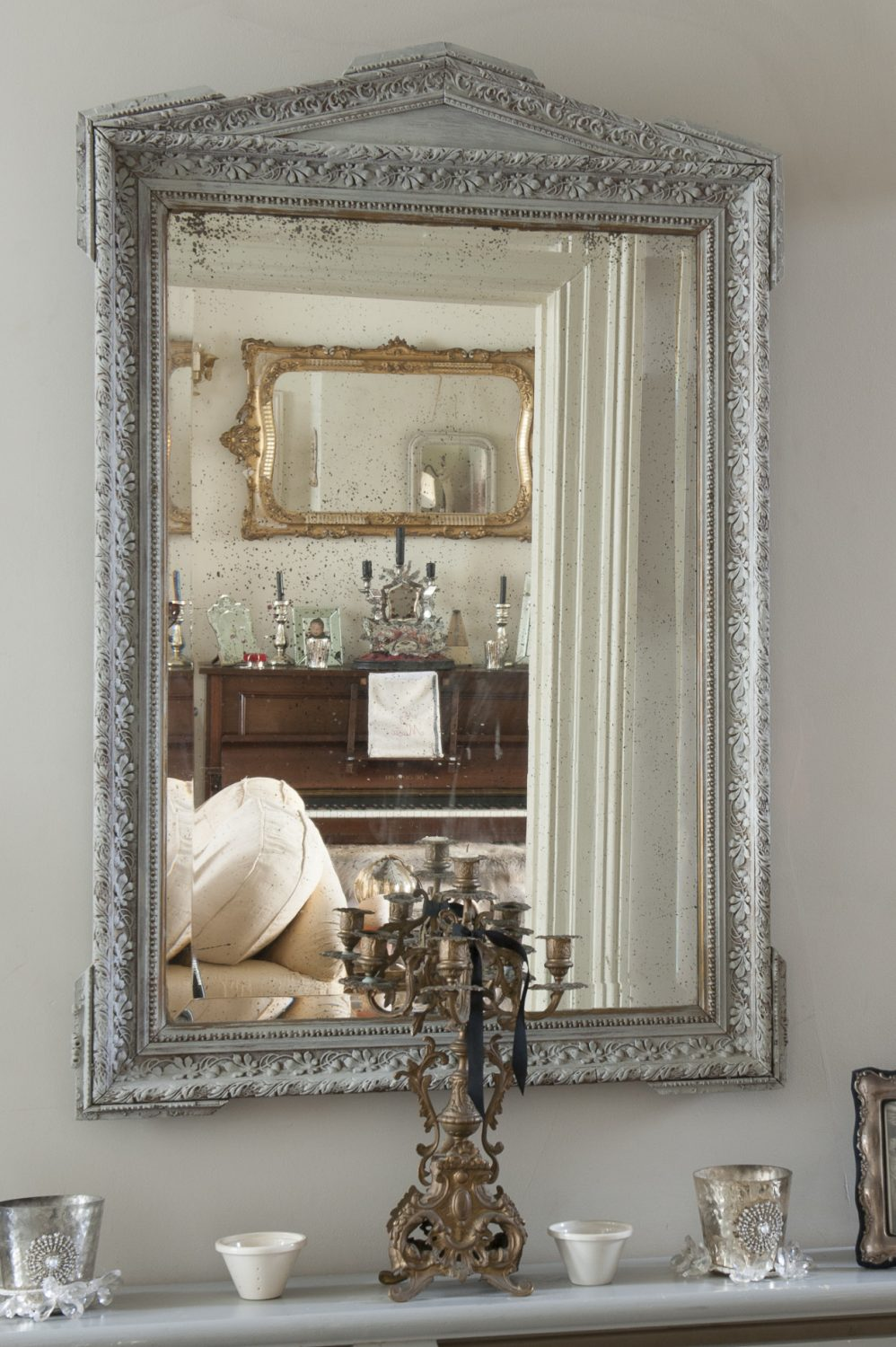 Antique mirrors are a prominent feature of Minnie's home
