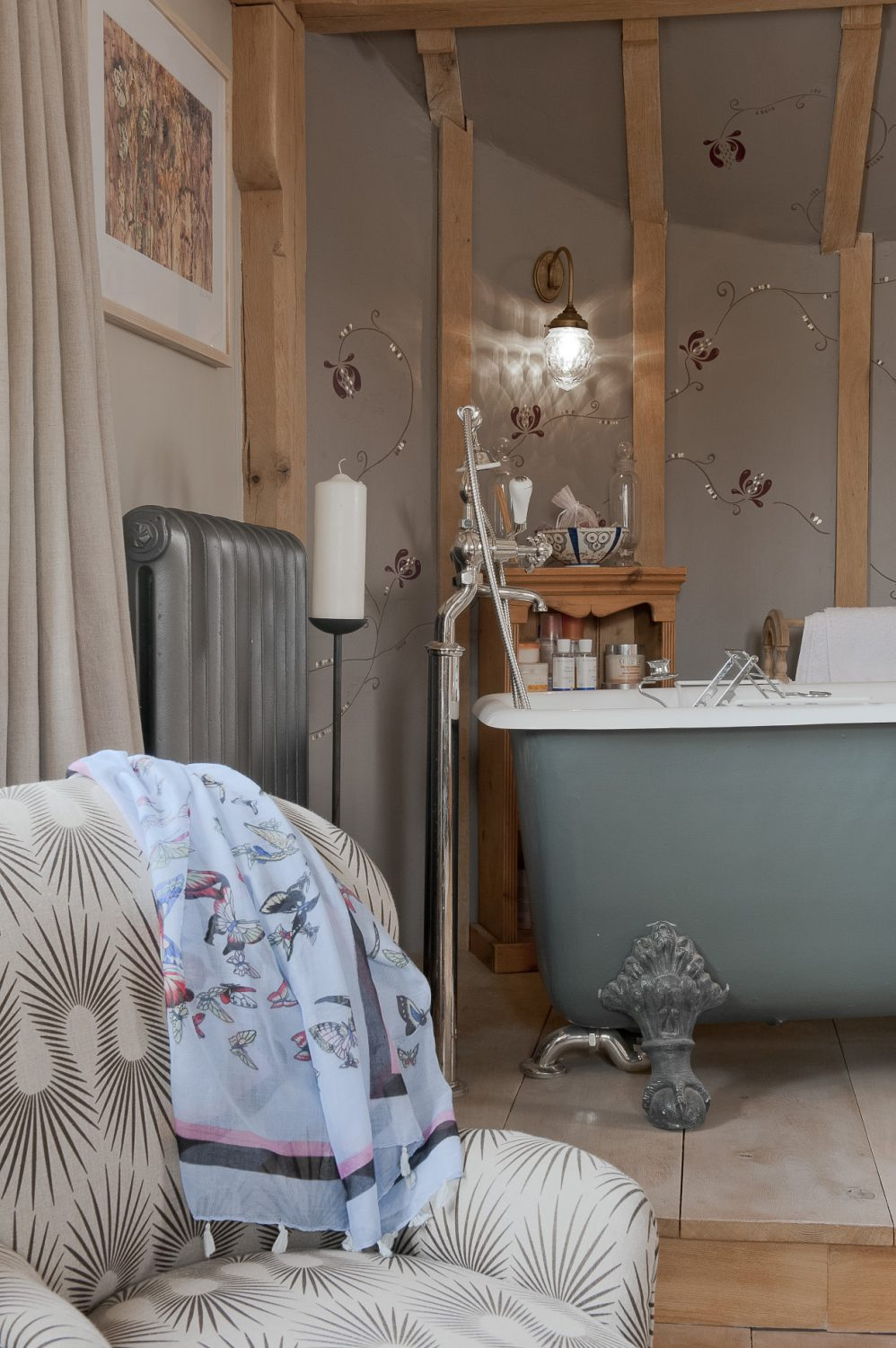 In Moyna and Richard's room a handsome rolltop bath is mounted on a dais in one corner