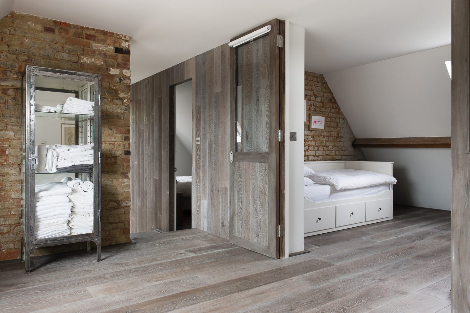 Throughout the house, exposed brickwork contrasts with the highly finished, sleek timber cladding and floorboards.Son Lucas's room has been designed to function as both a sleeping and study or games room. This is achieved through the use of partition doors that open out, or give privacy, depending on requirements