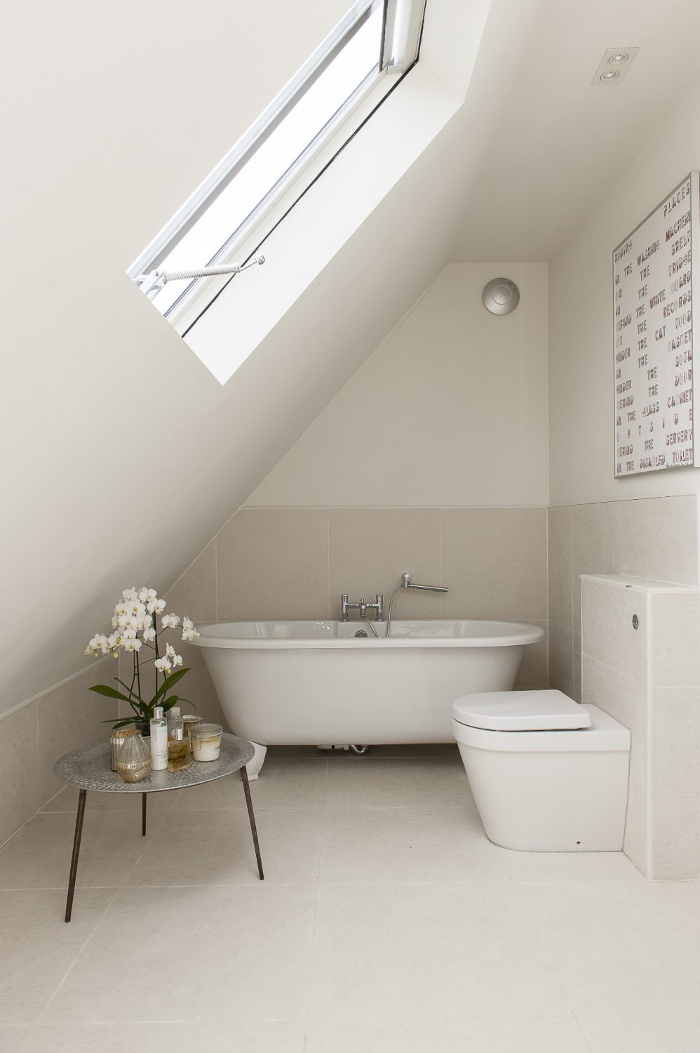 A family bathroom neatly slots into a space under the sloping roof upstairs