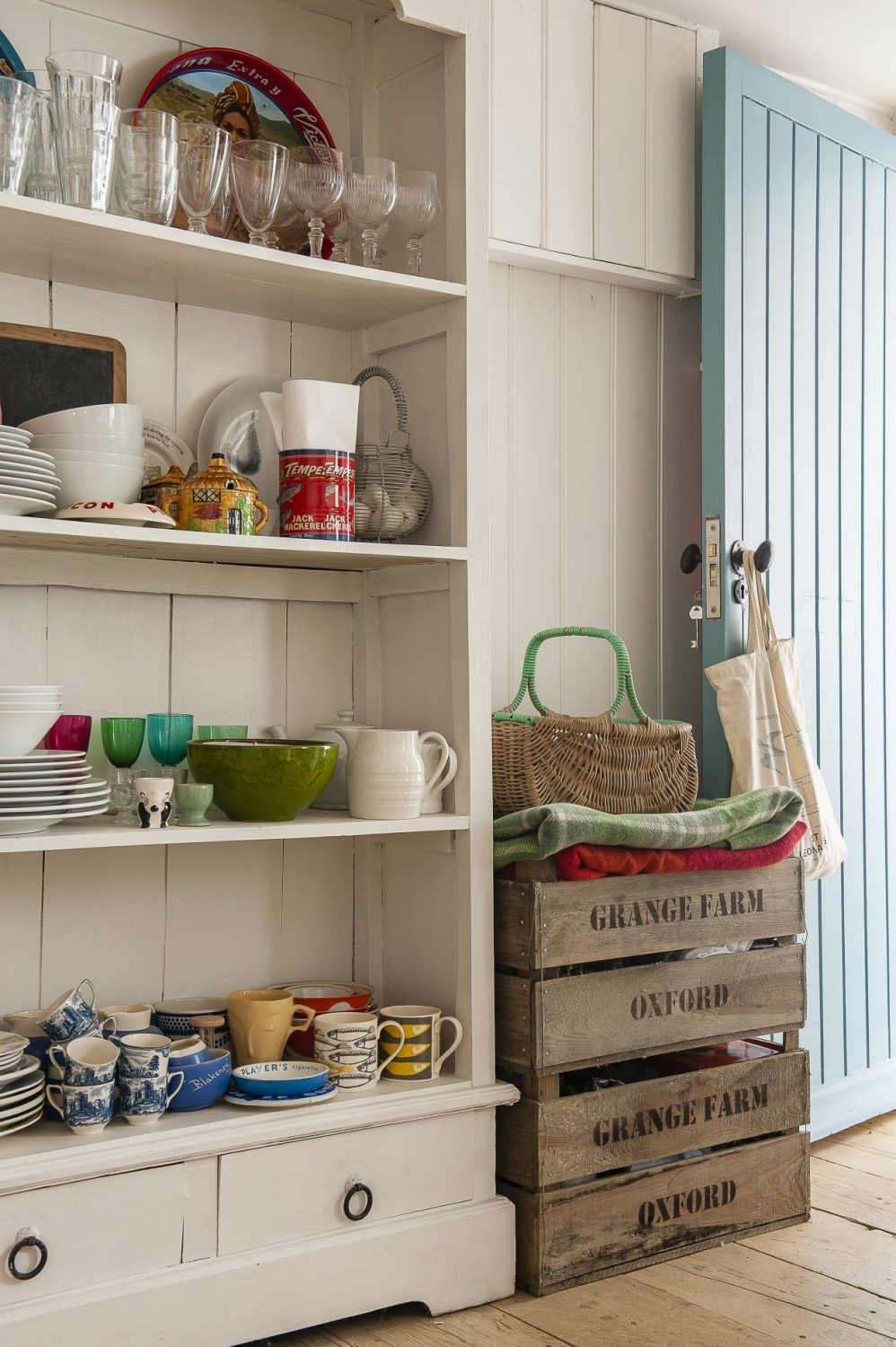 This includes the rack of wooden shelves by Garden Trading and everything in them: enamel bowls and jugs of various sizes, vintage cups and saucers and cook books
