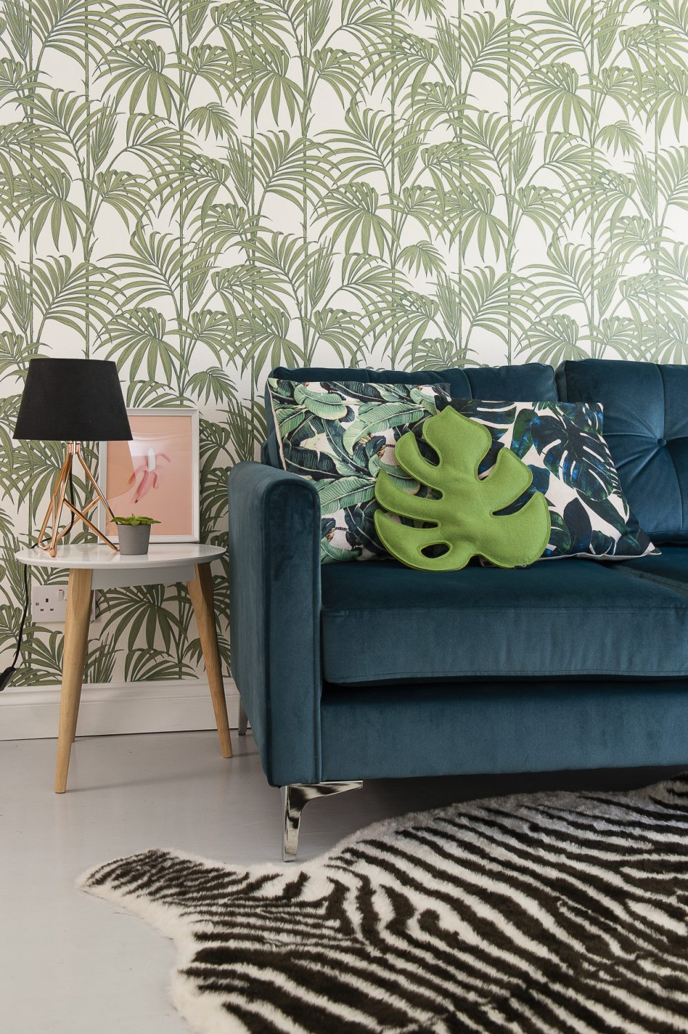 Lucinda sourced the velvet sofa in the playroom from DFS and the zebra rug is IKEA. The wallpaper is 'Honolulu' Palm Green from Graham & Brown