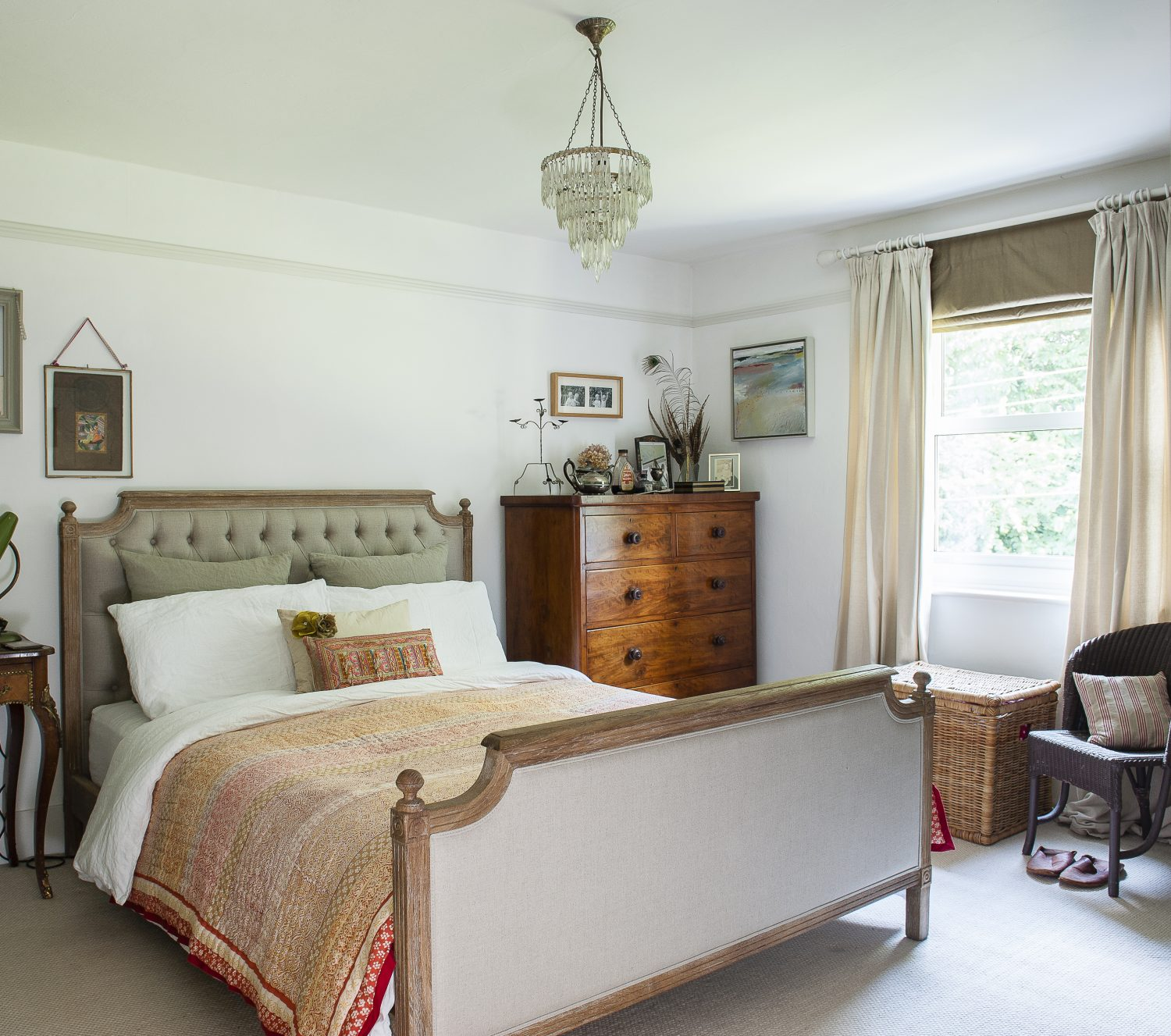 In the master bedroom, carefully arranged collections of treasures remind Karen of her travels and of loved people