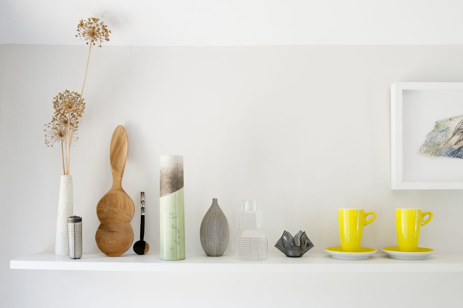 Karen's new kitchen has opened up the whole house, making the space much more useable for the family. Ceramics by Kate Schuricht are mixed with other objects on a shelf above the sink