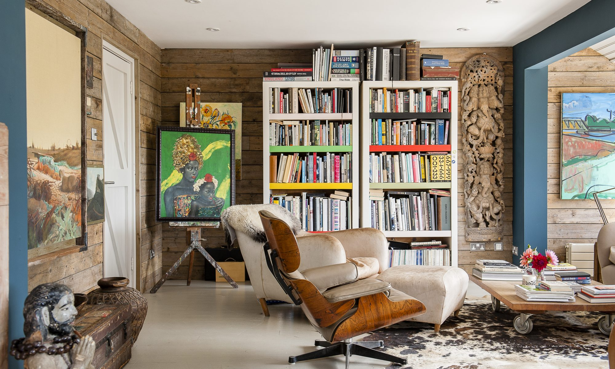 The wilder side of John and Anna's creativity comes out in their choice of artworks, with large scale original paintings – and some quirky eBay finds – in every room, mixed in with some very special photographs