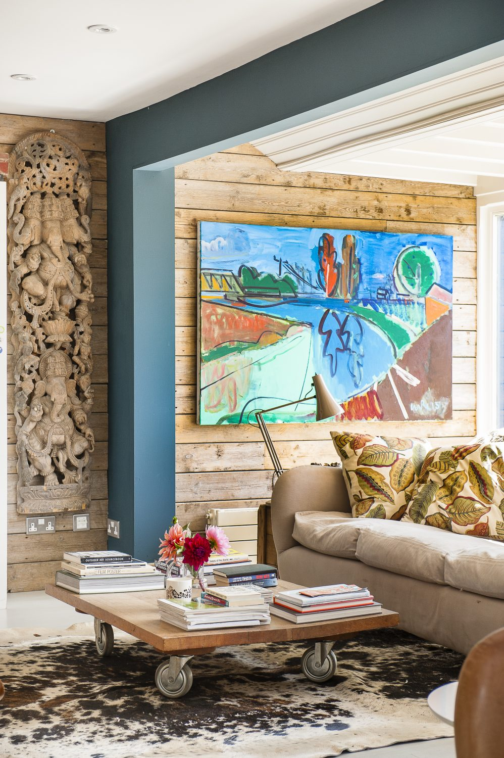 A Luke Hannam painting hangs in the sitting room