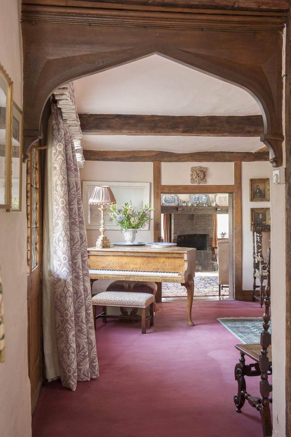 """Despite being such an old house, and in some ways a typical Wealden timber-framed building, it is surprisingly light inside with large rooms and relatively high ceilings. """"It's quite surprising, isn't it?"""" says Jane. """"Friends say it has a slightly Tuscan feel about it."""""""