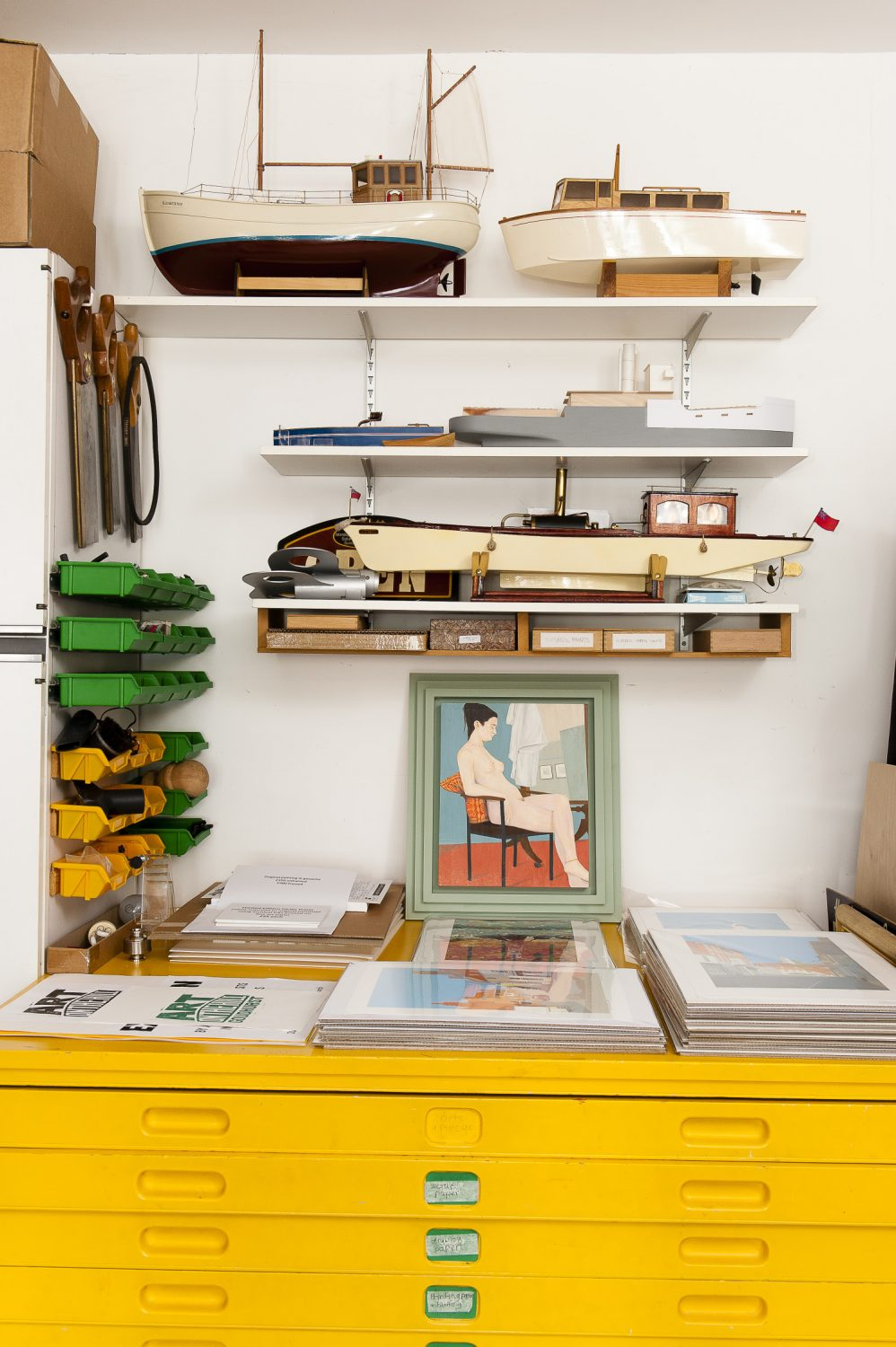 The studio is home to more of Dave's boats and a wonderful bright yellow plan chest