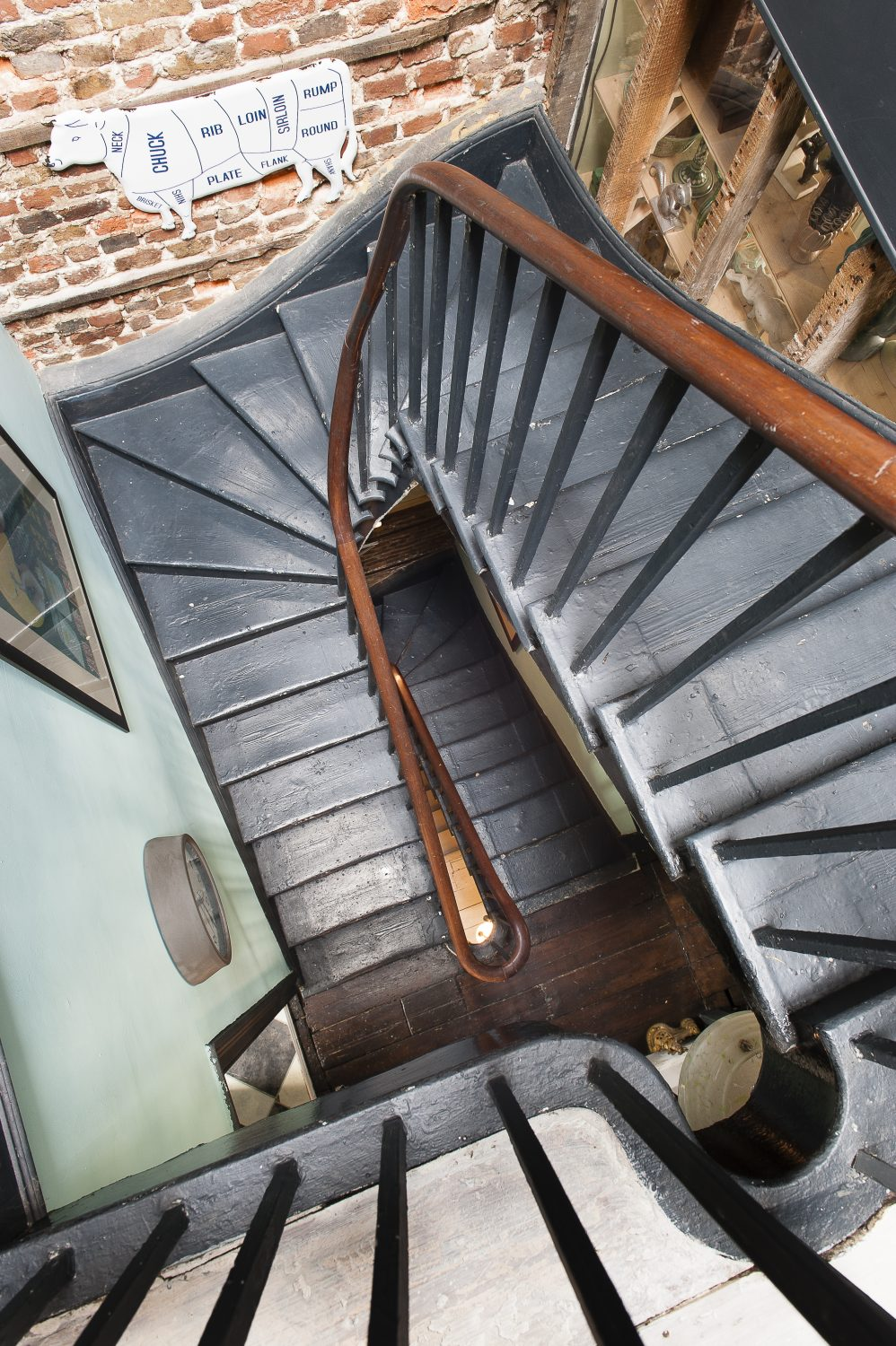 The staircase has become a striking feature in itself, rising just behind the shop, going up through the centre of the building