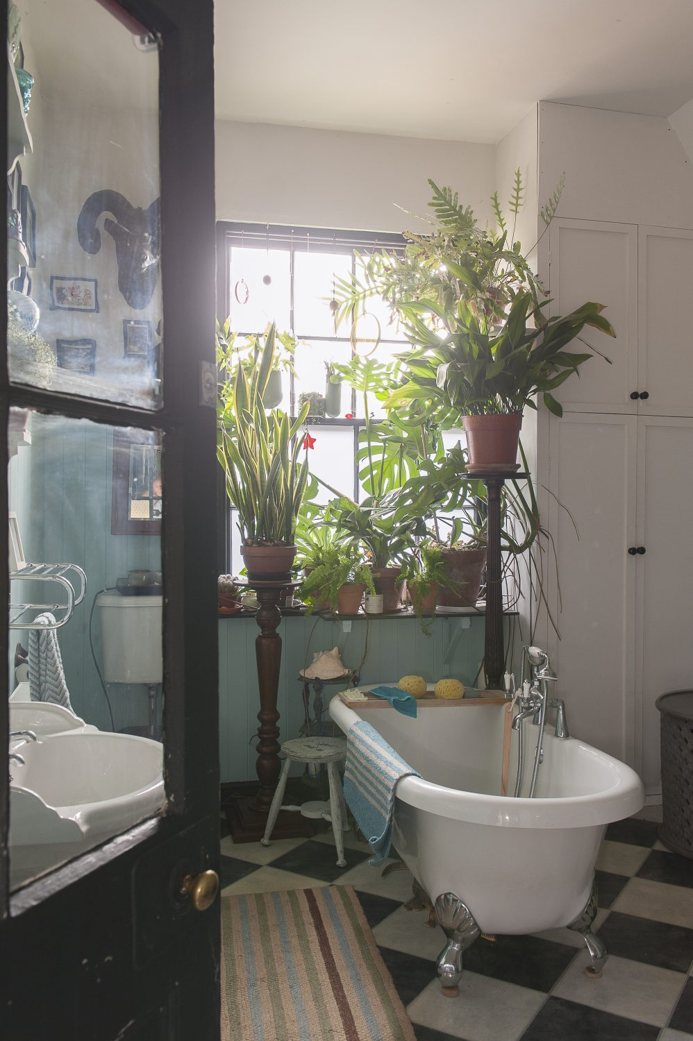 Nestled below a windowsill of tropical greenery the roll top bath offers the perfect place to unwind after a busy day in the shop