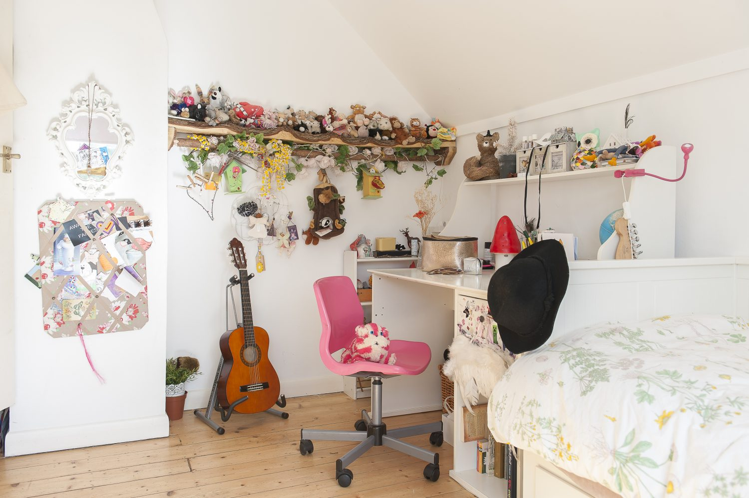 Elsie's bedroom is pure white and is calm and tidy, save for a single rustic oak shelf packed full of teddies and toys