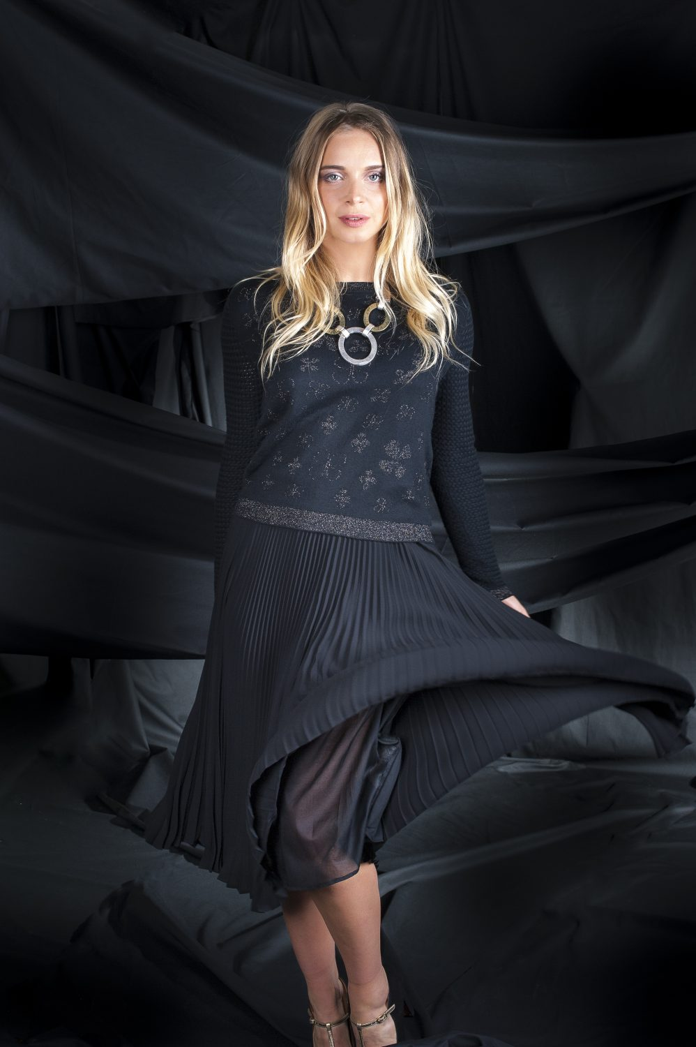 Penny Black pleated skirt, £169, sweater, £125, Niche, Rye, niche-online.co.uk 01797 225 294; Chie Mihara shoes, £253 Golden Boot thegoldenboot.co.uk 01622 752349; necklace, £25, Who's Wearing What Boutique, St Leonards whoswearingwhat-boutique.co.uk 01424 272925