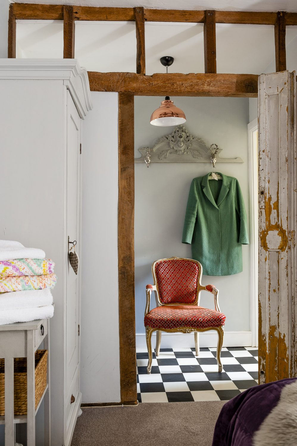 """Bargains and quirky finds have come from unexpected places and at different times: The copper effect lampshade in the bedroom is from Dunelm, some of the cushions and towels were from TK Maxx """"I didn't want to have to spend a fortune,"""" says Diane, """"if I can find something for a tenner that works, then that's good enough."""""""