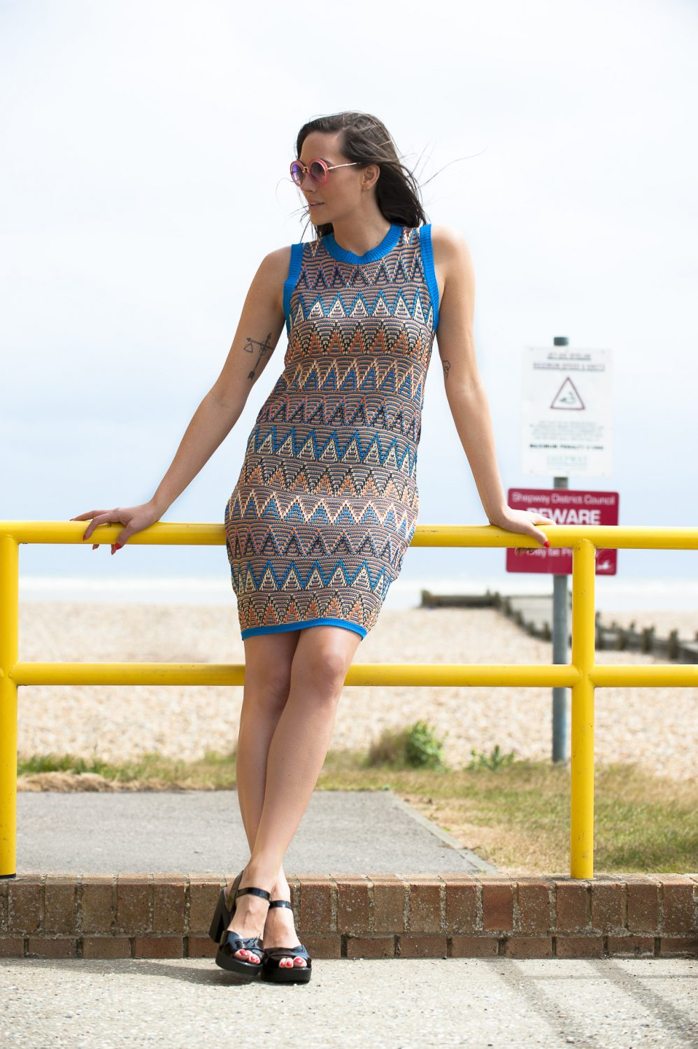 Shine knitted dress, £59, Reyflector sunglasses, £10, Who's Wearing What Boutique, St Leonards whoswearingwhat-boutique.co.uk; Wonders block heels, £95, Golden Boot, Maidstone thegoldenboot.co.uk