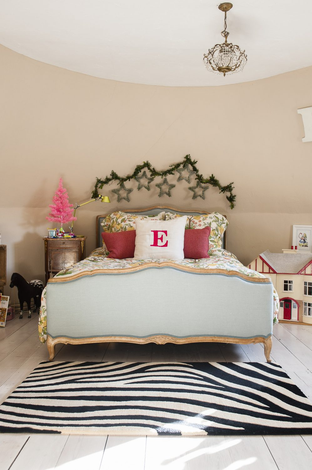 """I love beautiful beds,"" says Kali, ""I spend a long time finding exactly the right one for each room."" The children each have a cushion with their initials on – this one has a big rosy red E for her daughter."