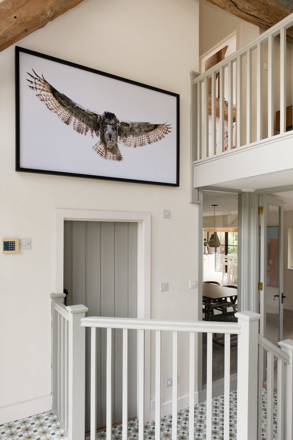 A large spread-winged owl, digital artwork created by Richard, looms over the galleried entrance hall