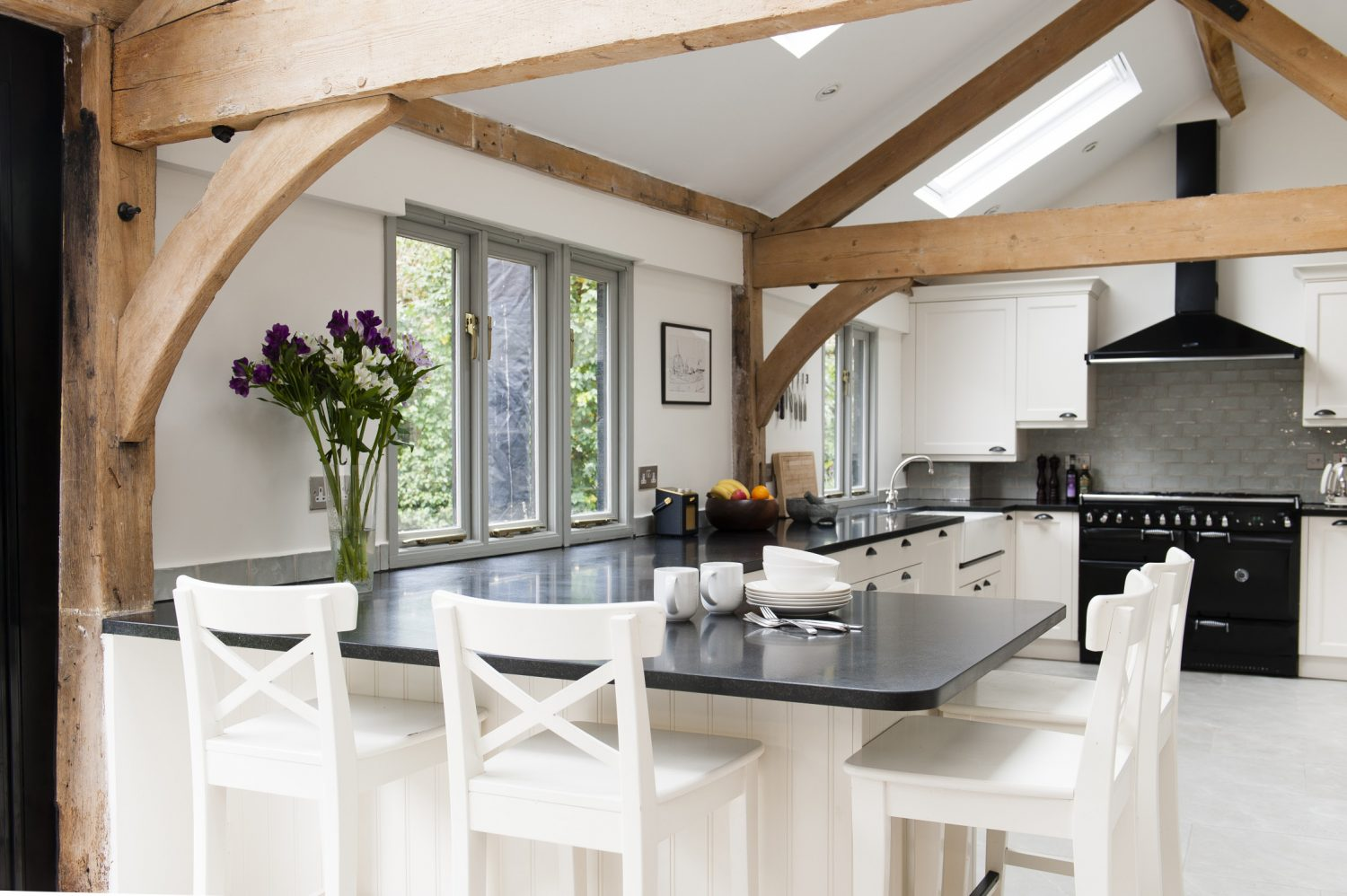 The kitchen is on the south-facing rear side of the house. Previously a dark room, Richard opened up the space and installed three Velux windows so light pours in, right through into the dining area