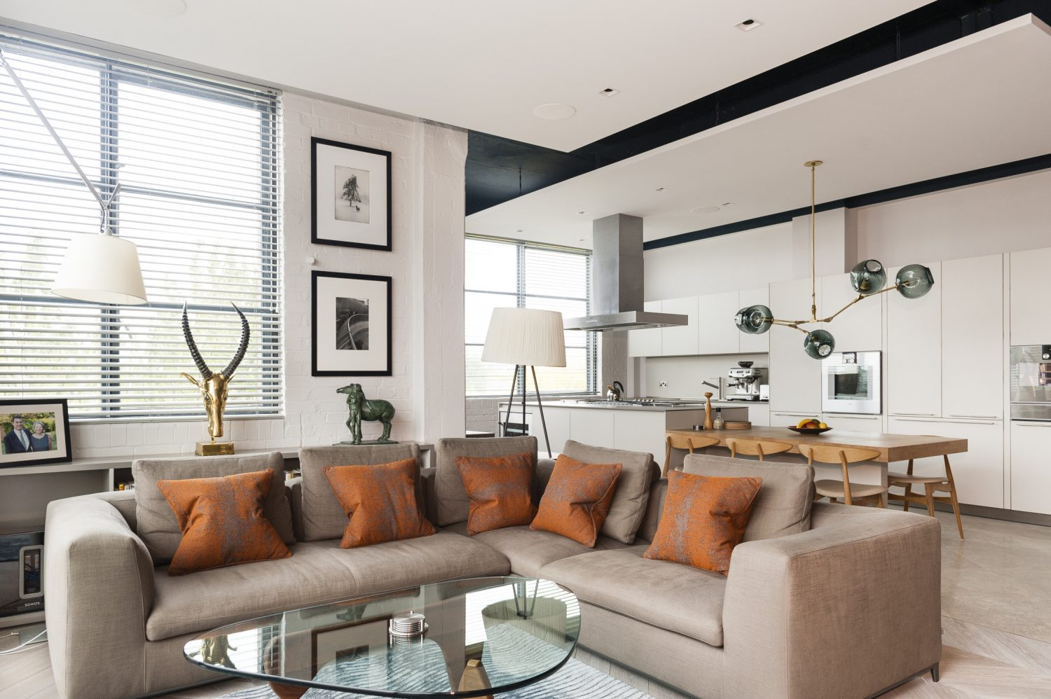 It is clear that art is important to Mike and Caroline, and their numerous pieces are shown off to good effect by the muted colour scheme in the open plan area of the apartment