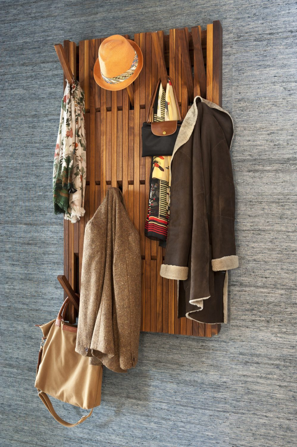 The spacious entrance way, with its artful piano coat rack is wonderfully uncluttered