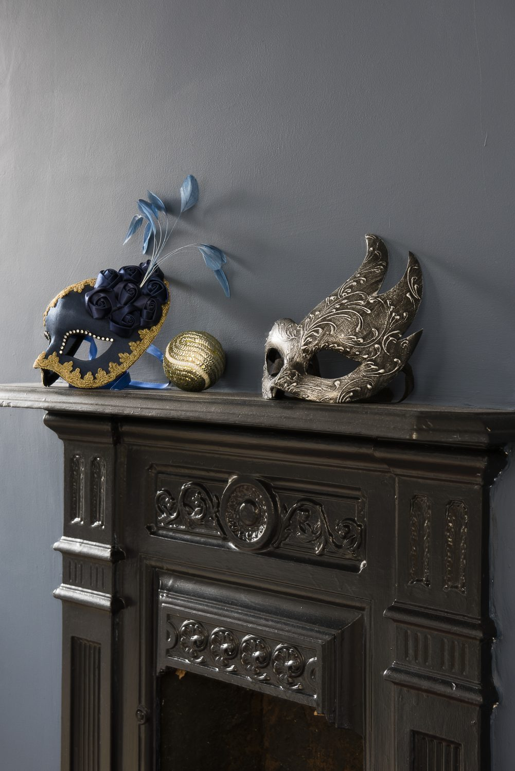 Venetian masquerade masks on the mantlepiece were a present from Simon