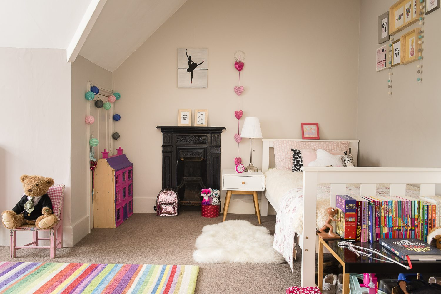 Tilly's spacious room, at the front of the house, looks over the school playing field Left: Oscar's room was difficult to fit furniture in because of the sloping ceiling. His bed was from Little Home children's range by John Lewis.