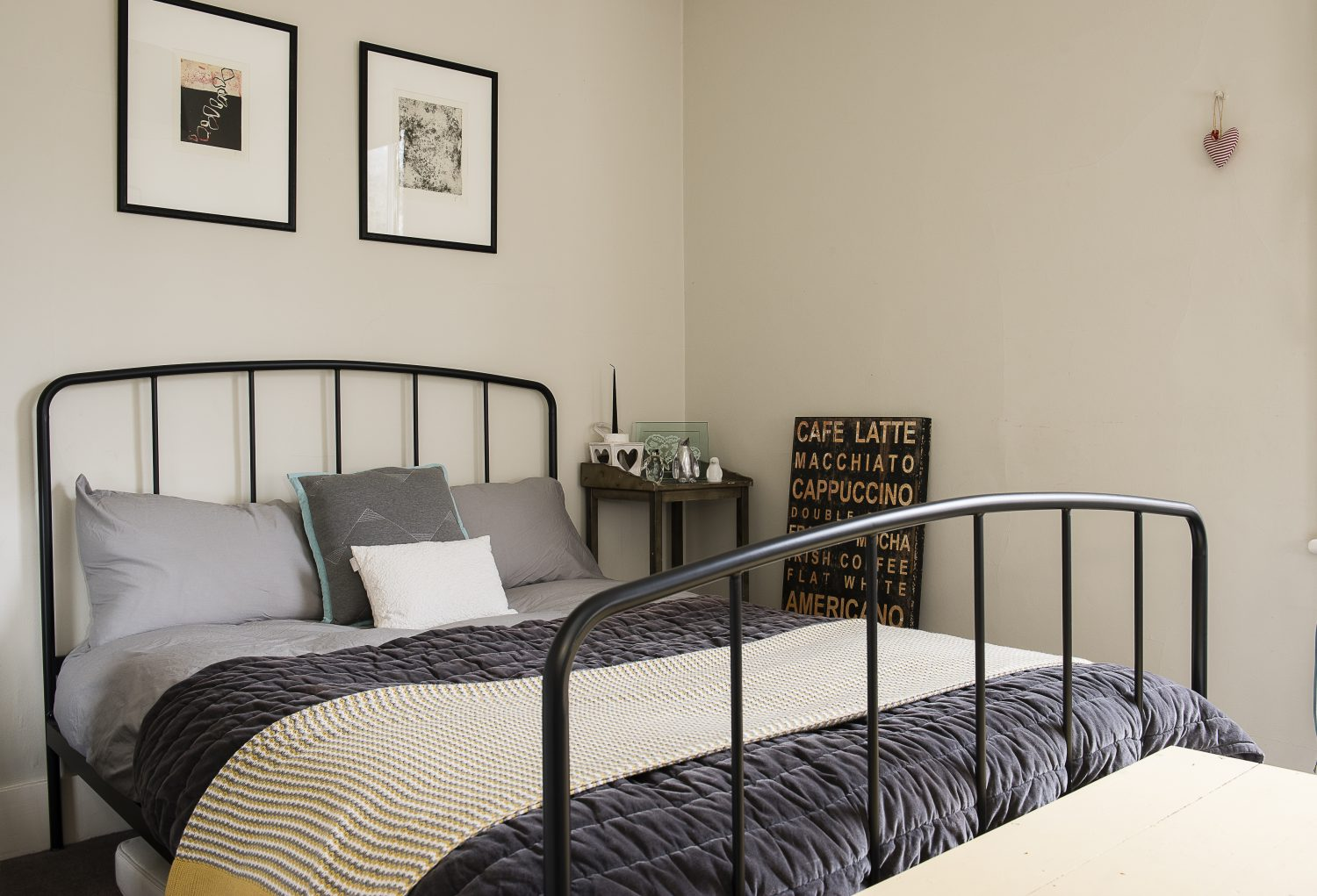 The guest bedroom features a metal bed frame from Made.com