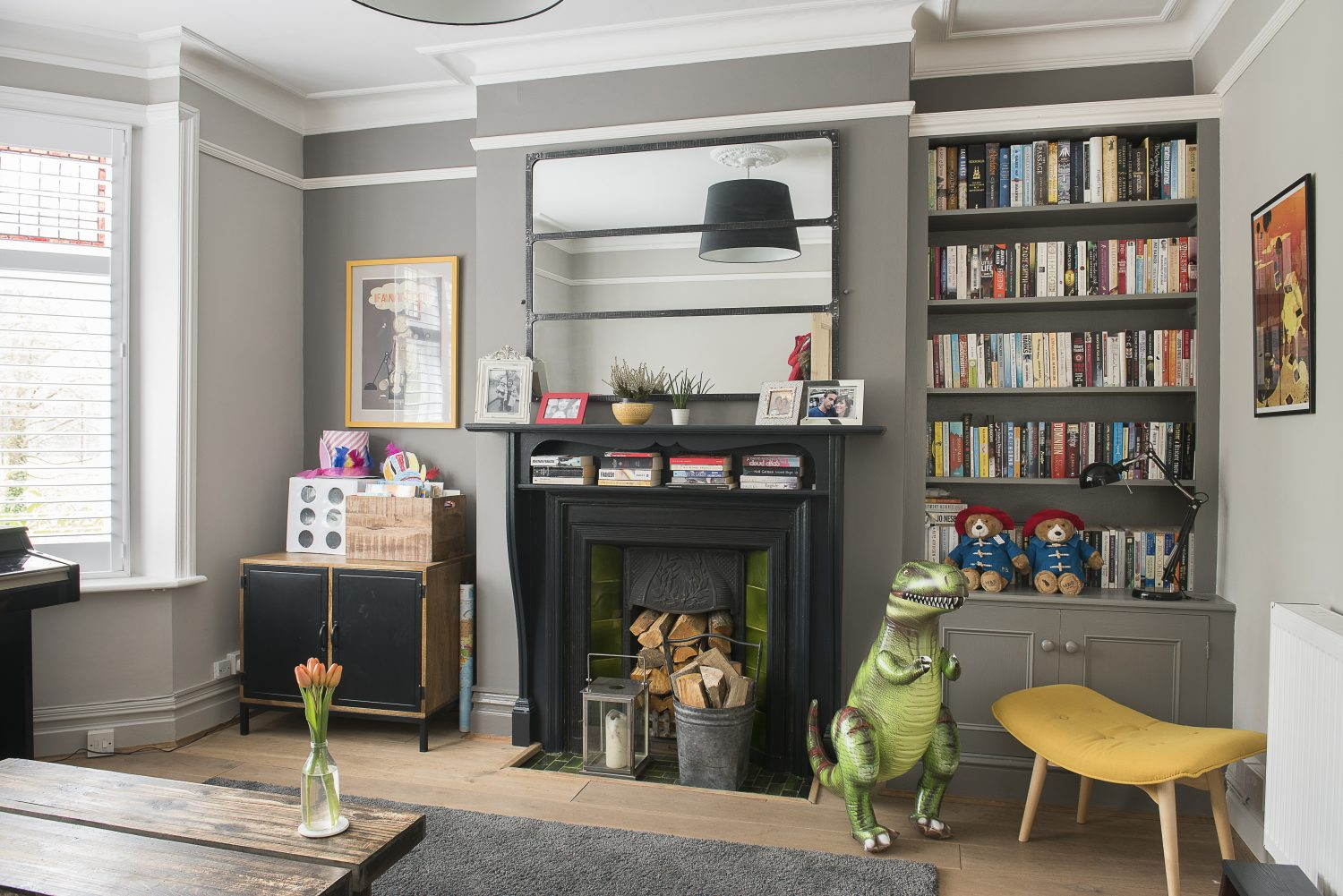 Caroline initially intended on turning the playroom at the front of the house into a snug. The walls are painted in Pavilion Gray and Mole's Breath by Farrow & Ball and prints on the wall were found at Battersea Affordable Art Fair