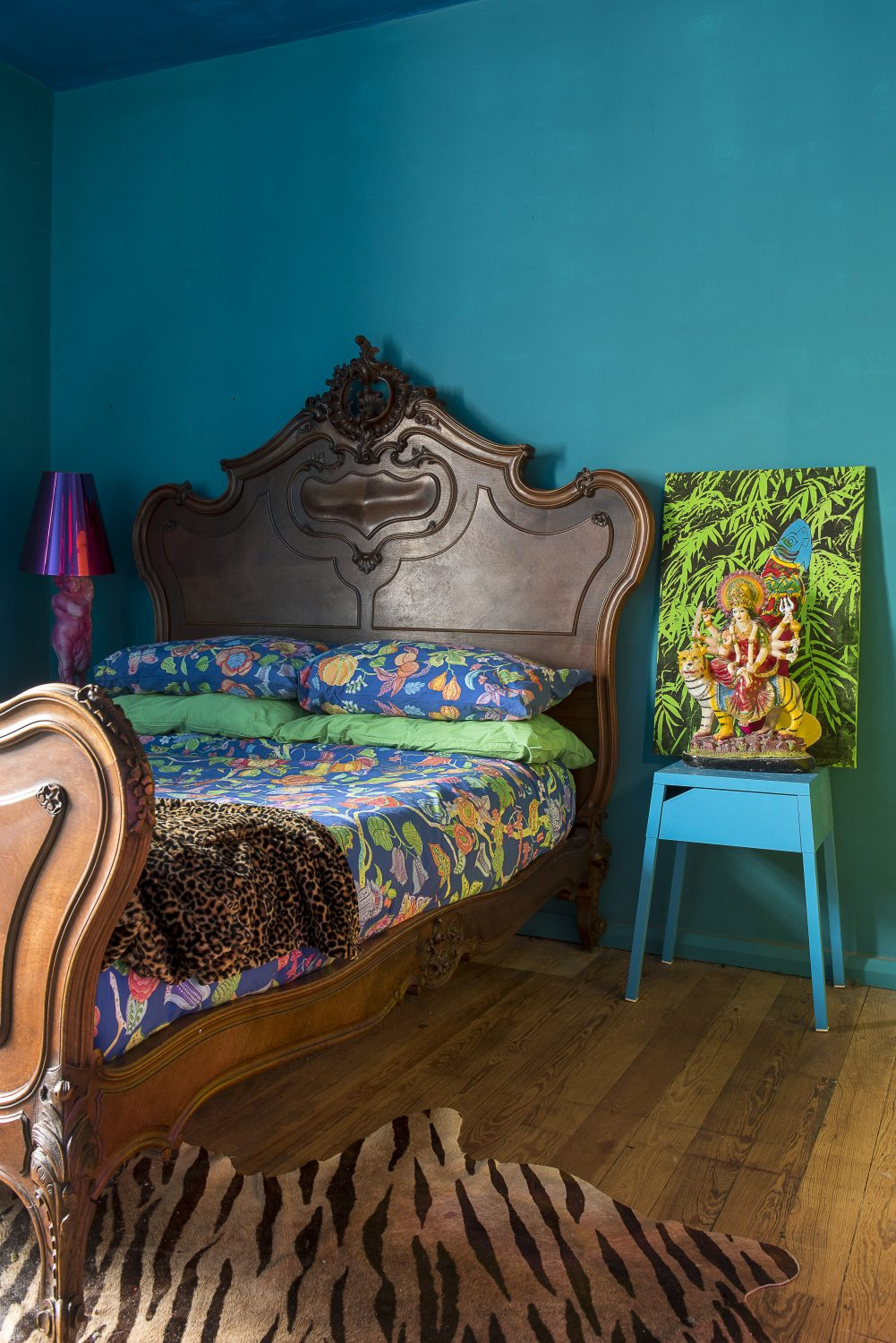 "The walls of the bedroom have been painted a deep teal colour. ""I was worried when I painted this room, as it came out much darker than I thought it would, but now the furniture's in, it looks okay,"" says Amy"