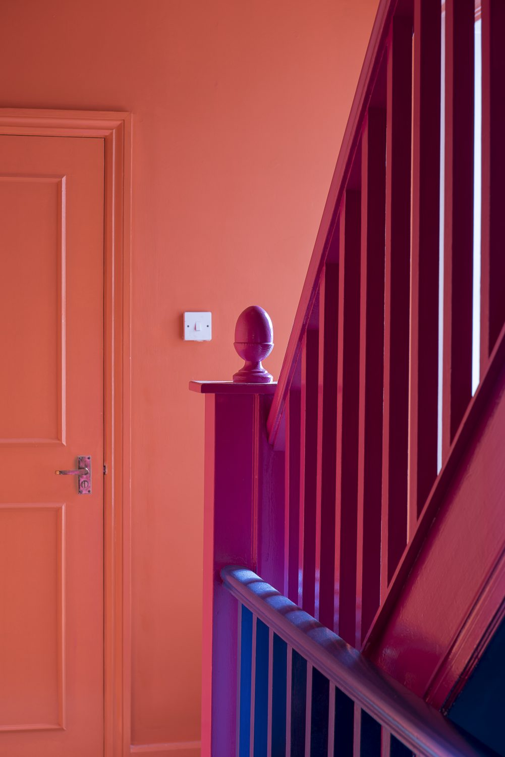 The staircase is a riot of pink and orange and is home to an Elvis bust spray painted by Amy the day before our visit