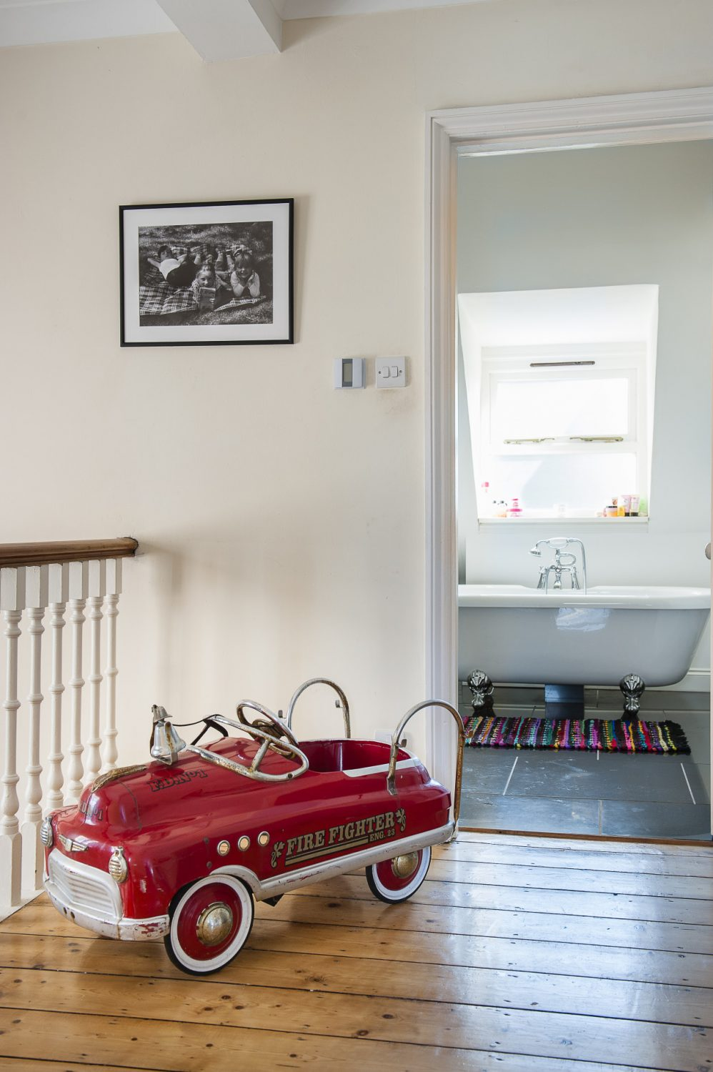 The children have the top storey of the house to themselves. The vintage firefighters' truck is from London Road Antiques, in St Leonards