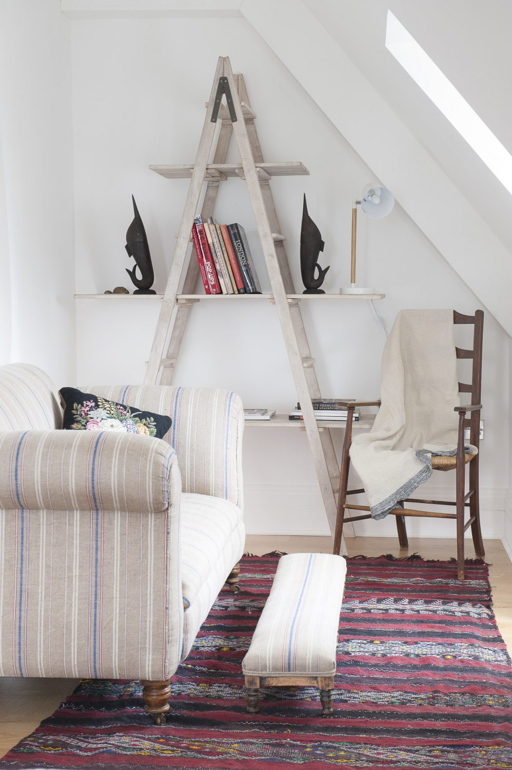 Throughout the house there are oak floorboards covered with antique rugs and kelims, a look that works particularly well on the landing from which all the bedrooms lead