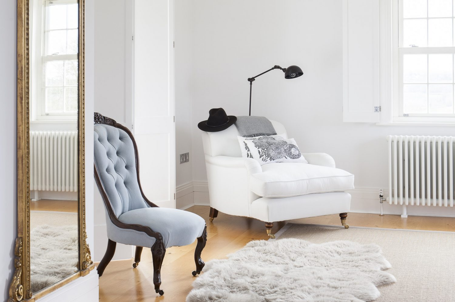 The master bedroom is painted in a very pale, restful grey and is delightfully simple