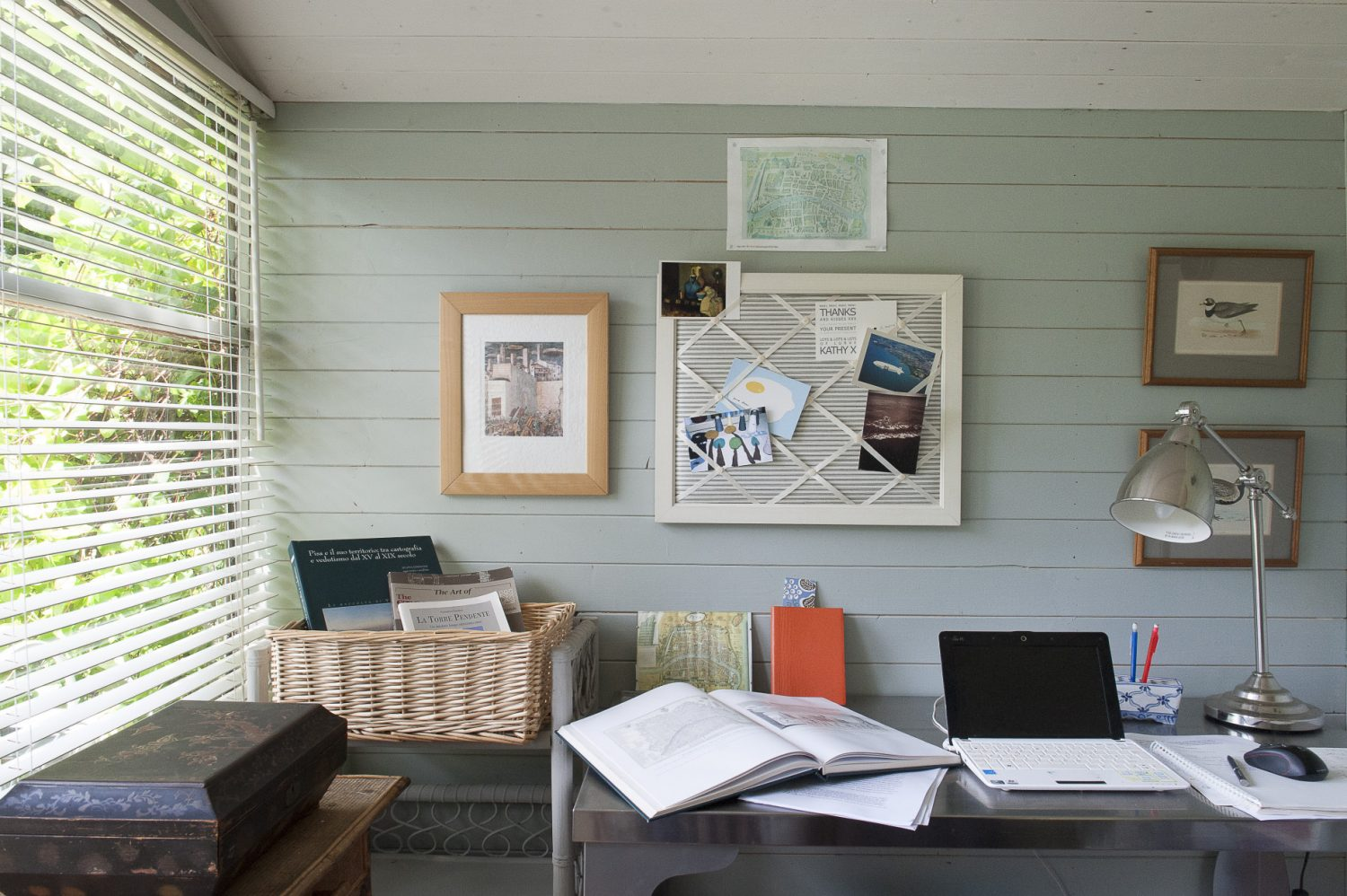 In order to write, Debbie escapes to the summerhouse tucked away in a corner of the garden. Previously rather neglected, it is now a smart tongue and groove clad sanctuary painted in a very restful pale blue, the perfect place to write a novel