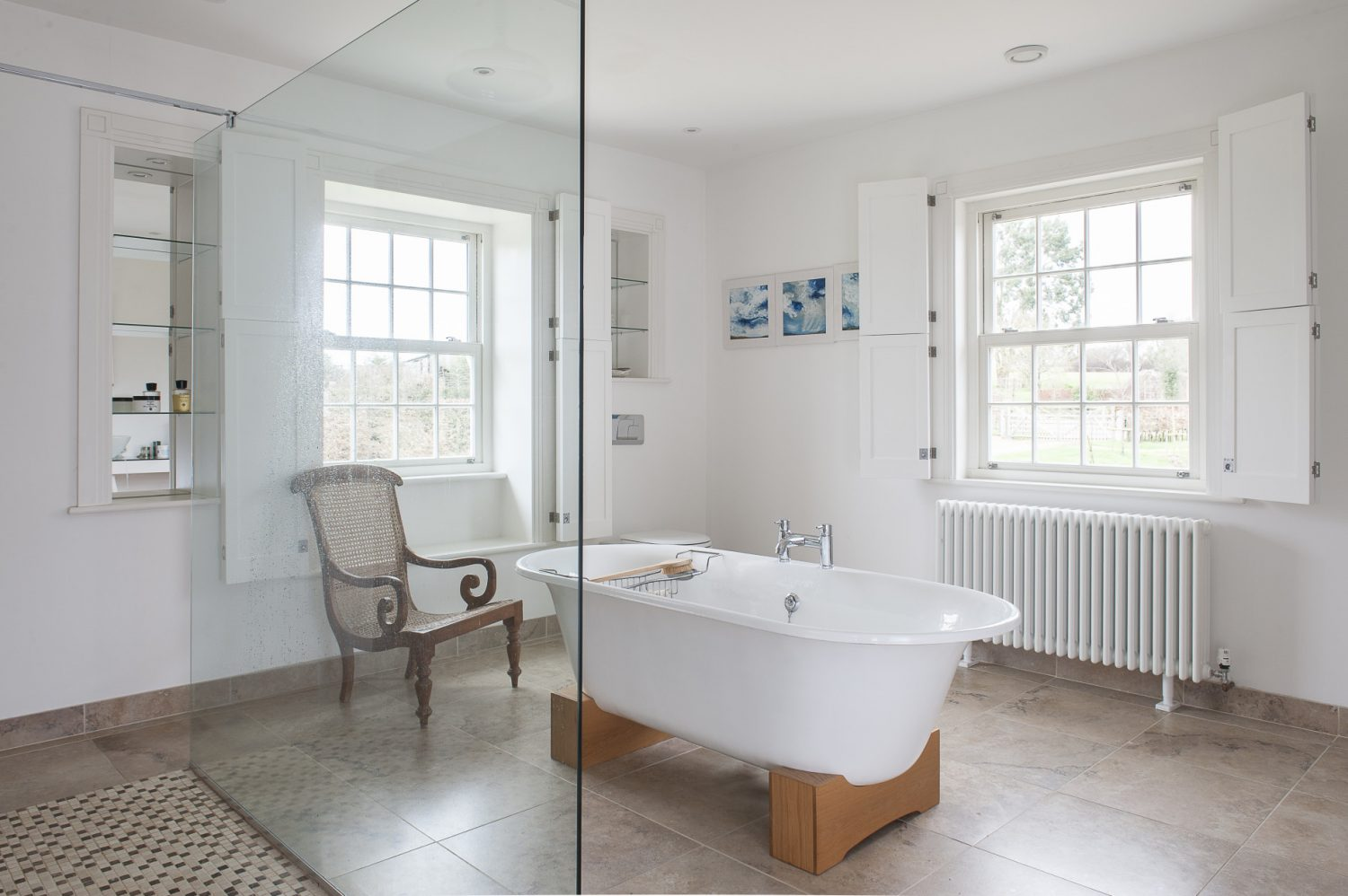The en suite bathroom has a free-standing bath in the middle of the room and a to-die-for walk-through shower along one side. Ceramic tiles that look just like limestone (but are much easier to keep clean if you live in a hard water area) have been used and look great