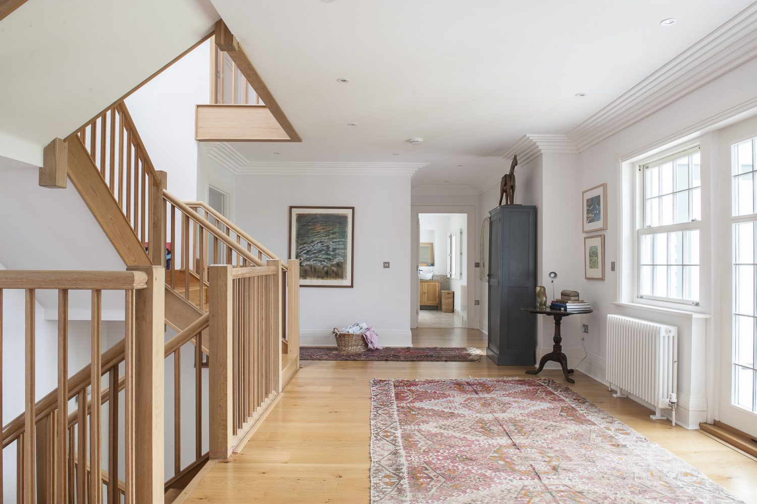 The central oak staircase was only half built when the family bought the house but is now an intrinsic part of the four-storey home – linking three of the four floors. A glass cupola over the stairwell throws light into all of the rooms that lead off this impressive space