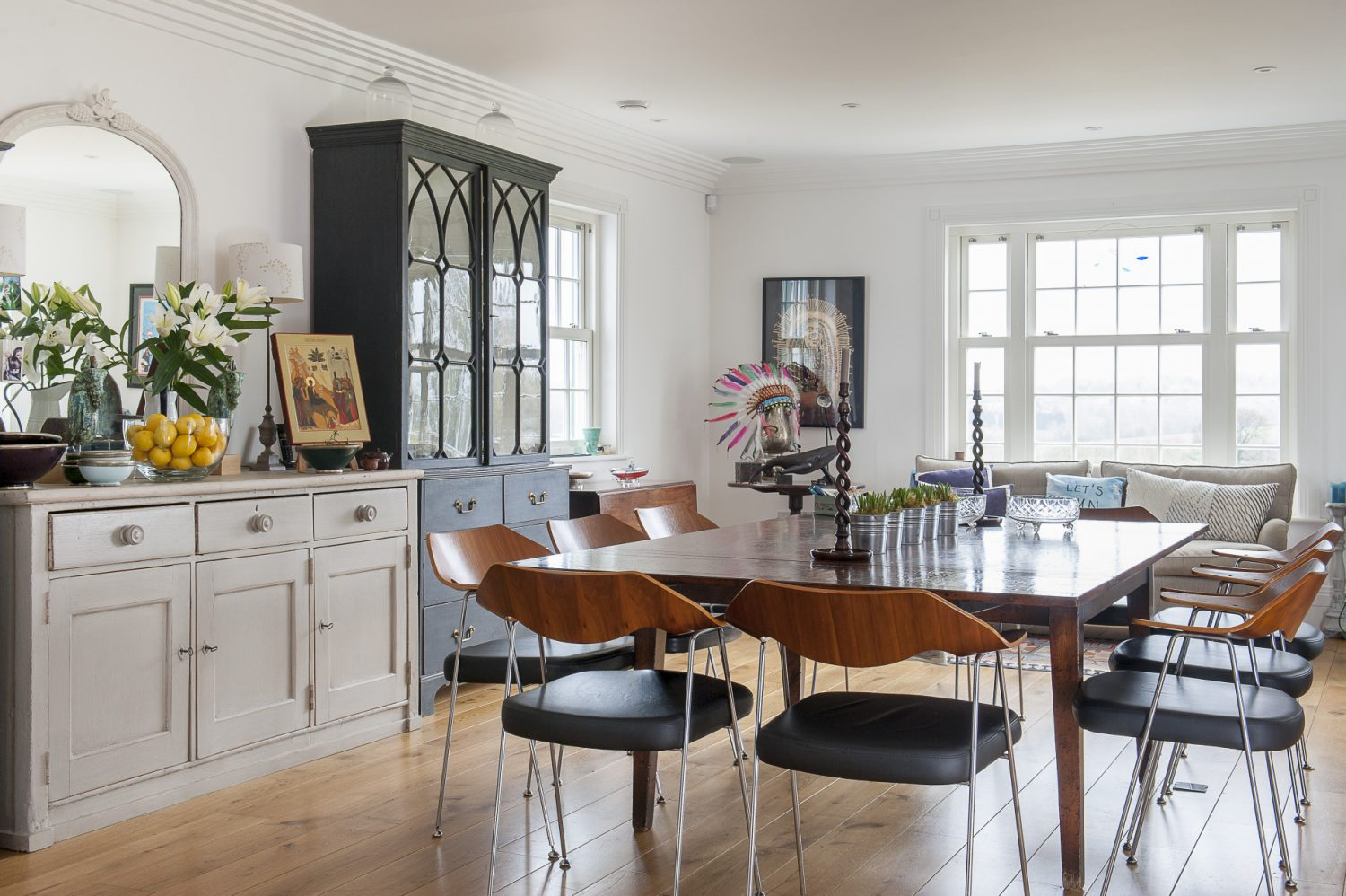 The Smiths' light-filled home, decorated in white and grey, is the perfect backdrop for artefacts, paintings, sculptures and junk finds that the family have collected during their travels. The dining chairs are copies of a classic 1960s Robin Day 365 design, bought from Habitat many years ago