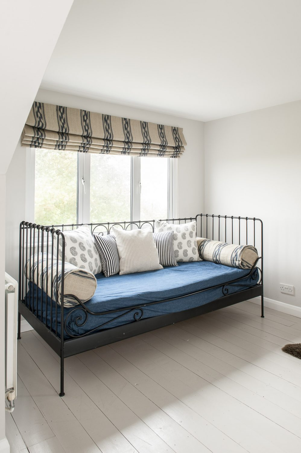 Wrought-iron daybed from IKEA. Francesca designed the Roman blind, which is in Ralph Lauren fabric
