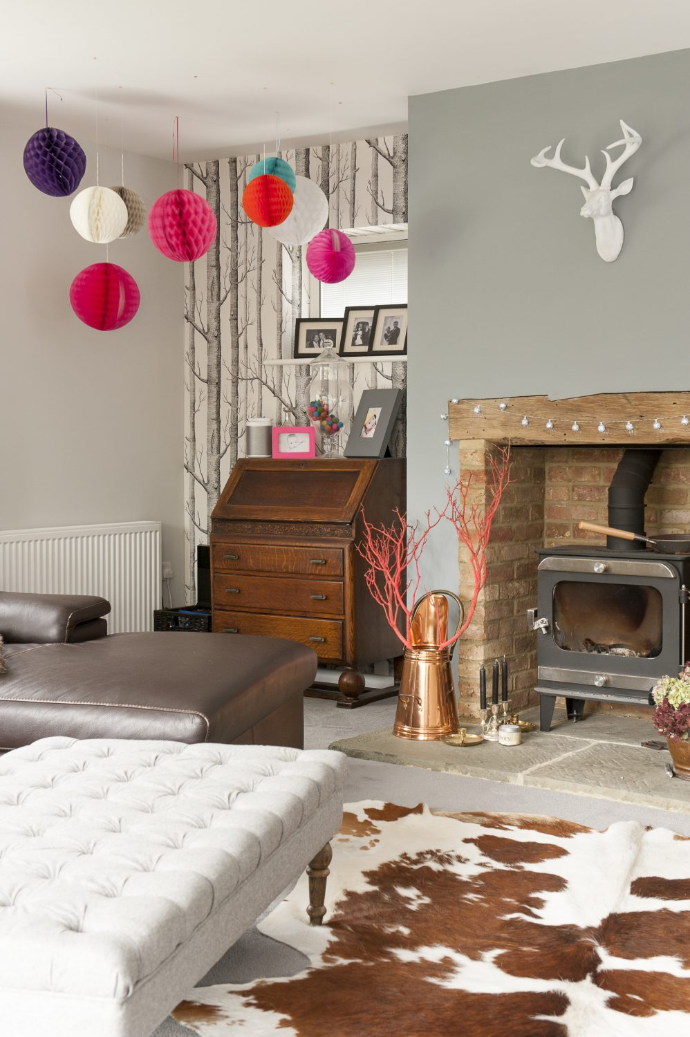 The sititng room features a reclaimed brick fireplace with oak bressumer – both the bricks and wood were sourced from Symonds Salvage in Bethersden