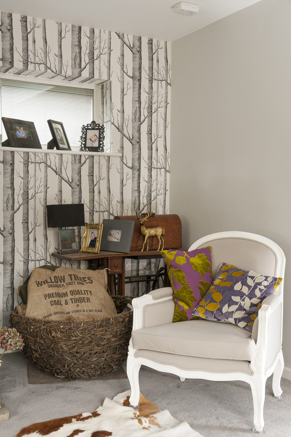 The walls are papered in Cole & Son's 'Wood' range that nicely welcomes in the garden beyond