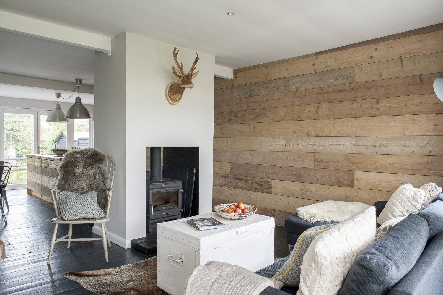 The chair is from Strand Quay Antiques and the sheepskin from Hunter Jones, both in Rye. The wooden stag's head is from Eras of Style in Bexhill