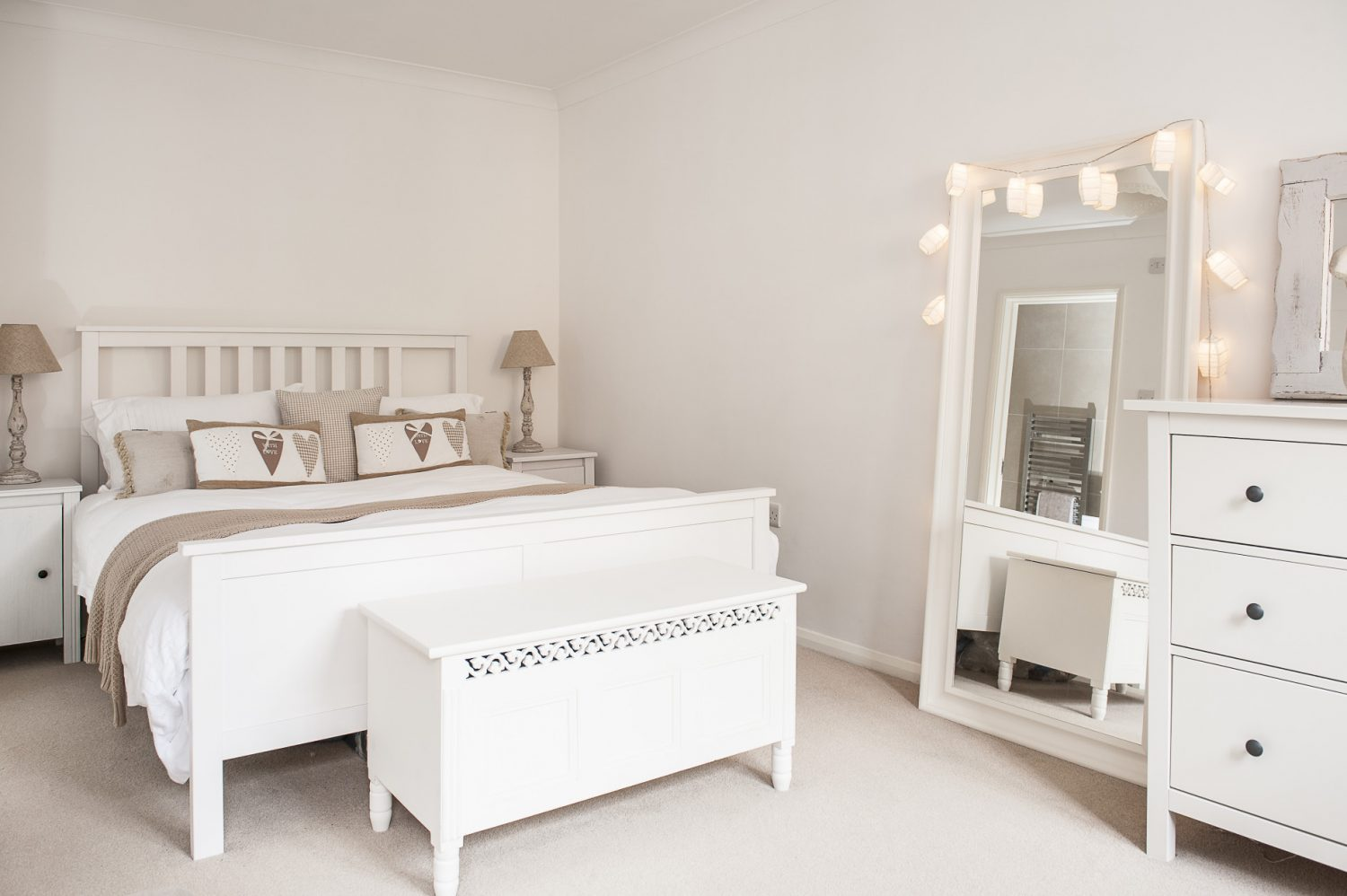 Situated on the ground floor, the master bedroom is a cool white space dotted with soft furnishings courtesy of one of Chris's favourite shops, The White Company, plus cushions that she has crafted herself