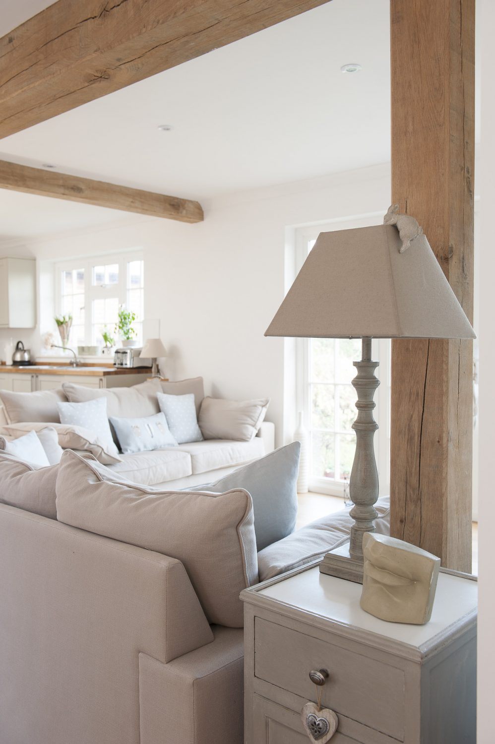 Adhering to a clean palette of whites and shades of grey, Christine has accessoried each room with crisp linens and painted wood furnishings ensuring that each room looks effortlessly uncluttered