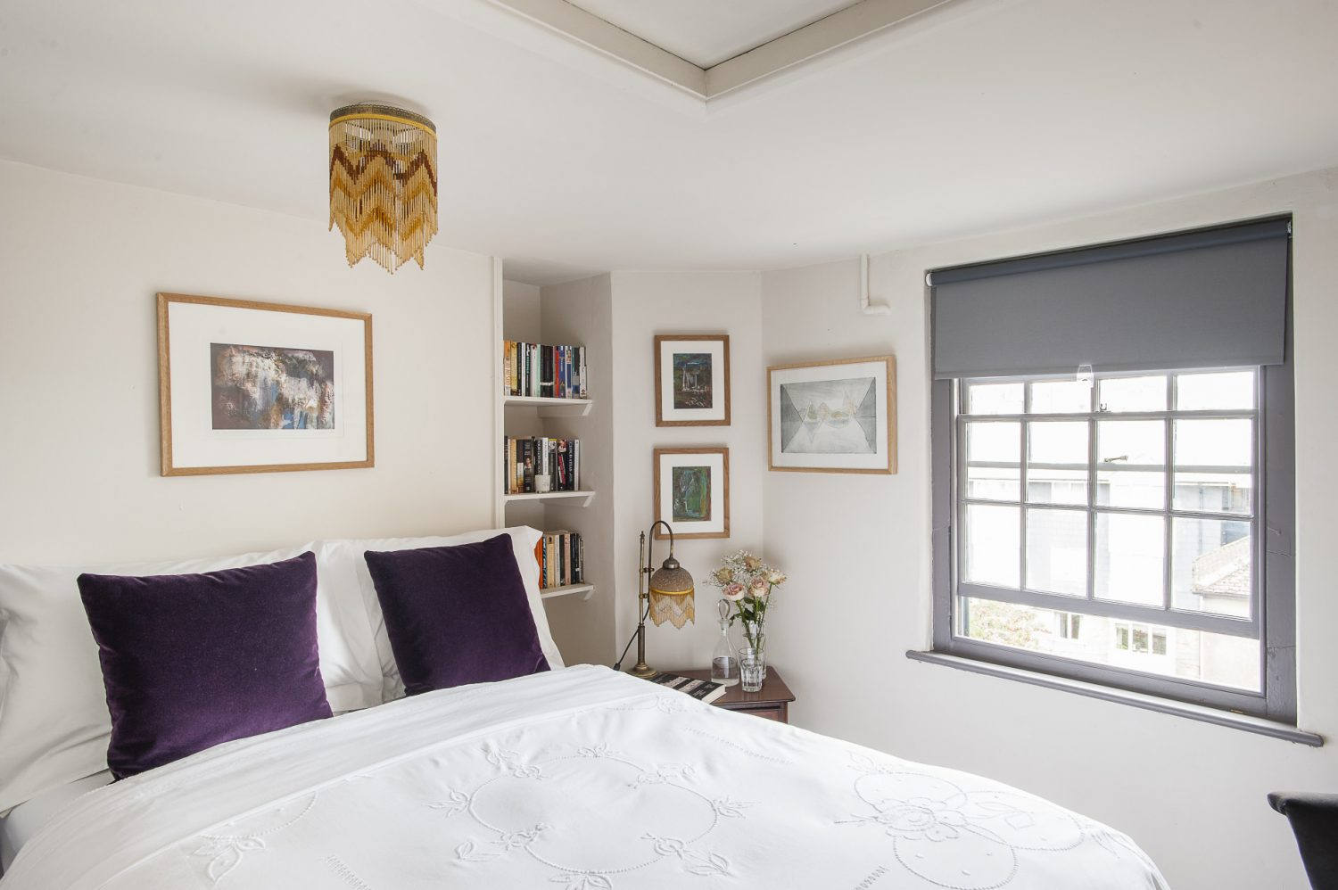 The spare room looks east over Hastings Old Town. The painting next to the window, called Winter Light, is by MG Fraser and depicts the Norwegian Lofoten Islands
