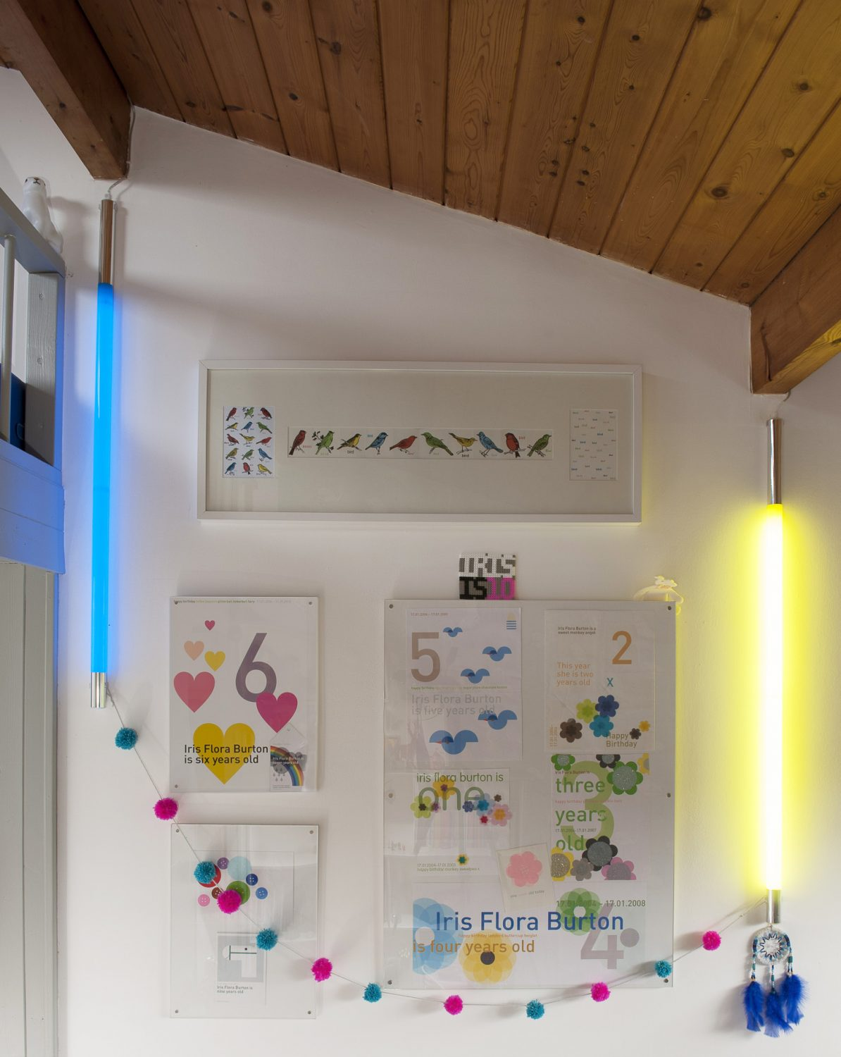 Primary-coloured strip lights create a soft glow on one wall