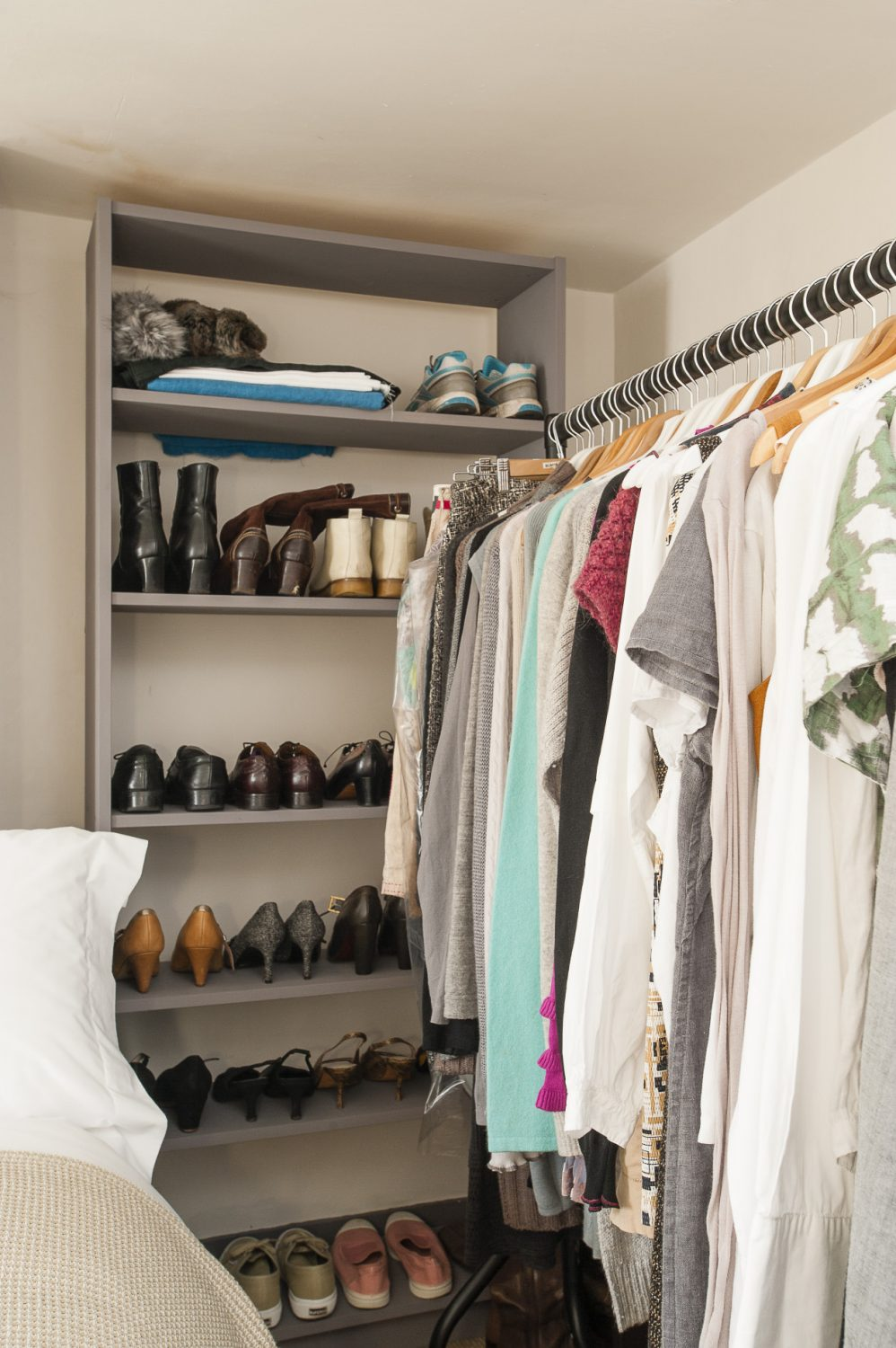 Rather than use up previous space with wardrobes, Christine stores her clothes on rails in the bedroom - and the study - and considers them part of the decor. A bookshelf, painted grey, makes a perfect shoe display