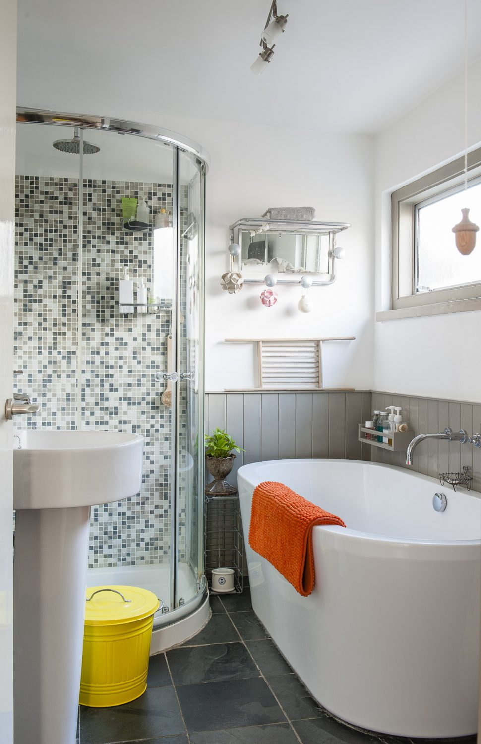 The family bathroom has been brought into the 21st century with modern fixtures and fittings. Richard has added wrap around tongue and groove, now painted a French grey to complement the slate flooring and mosaic tiles of the shower. Both the basin and free-standing bath are from eBay.