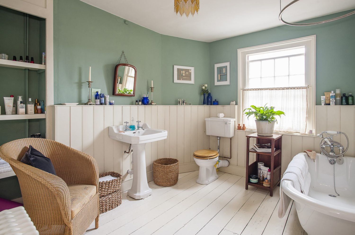 All the walls in the house are lime plastered, so the paint used had to be 'breathable'. The colour in the bathroom is Chappell Green by Farrow & Ball. The cream paint used throughout the house is Marbles by Earthborn. The plant is a peace lily