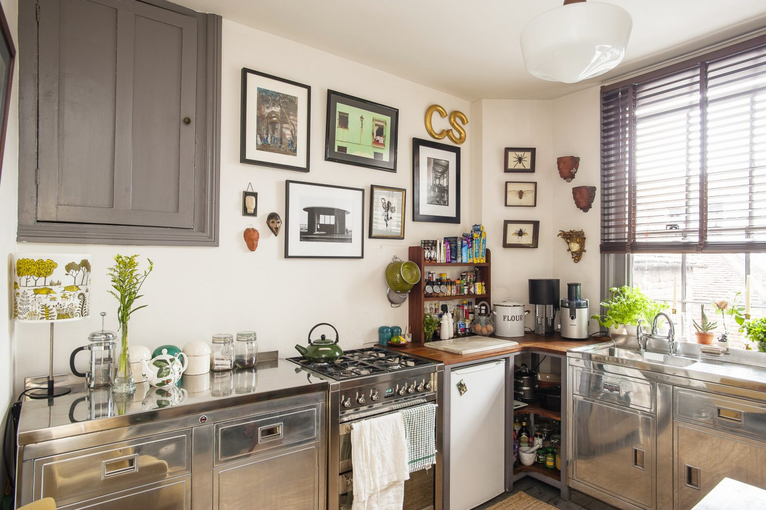 The 1950s Dovedale kitchen cabinets were already stripped of paint, Christine had the steel polished. She bought the Medusa mask and collection of insects at Greenwich Market in the 1980s